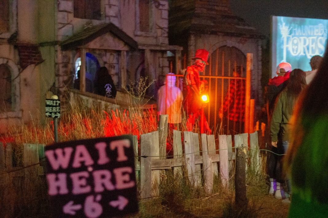 """Wait Here"" signs outside the Haunted Forest"