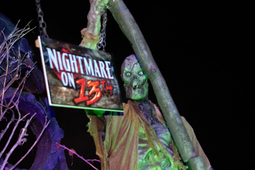 Ghoul holds Nightmare on 13th sign