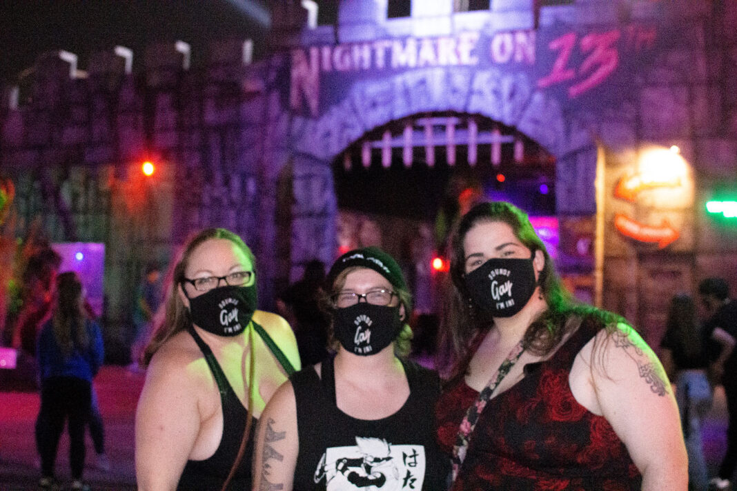 "Three women wearing masks that read ""Sounds Gay I'm In!"""