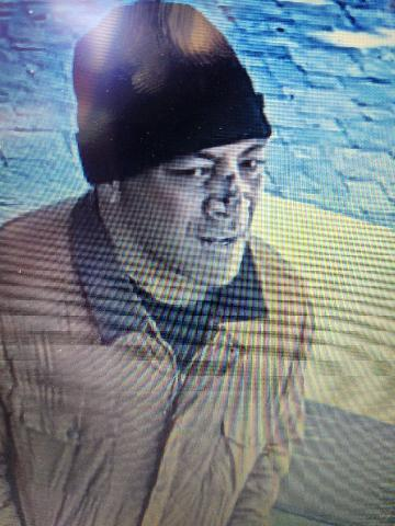 Polynesian man wearing brown coat and black beanie