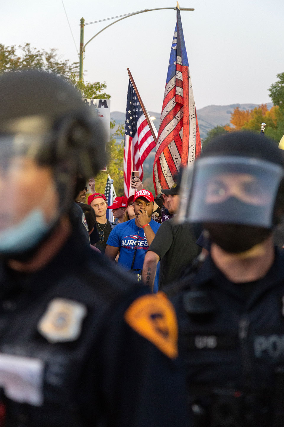 Protesters demonstrate behind police line