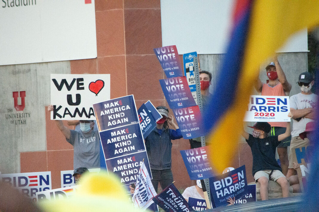 "Signs read ""Make America Kind Again"" and ""We Heart U Kamala"""
