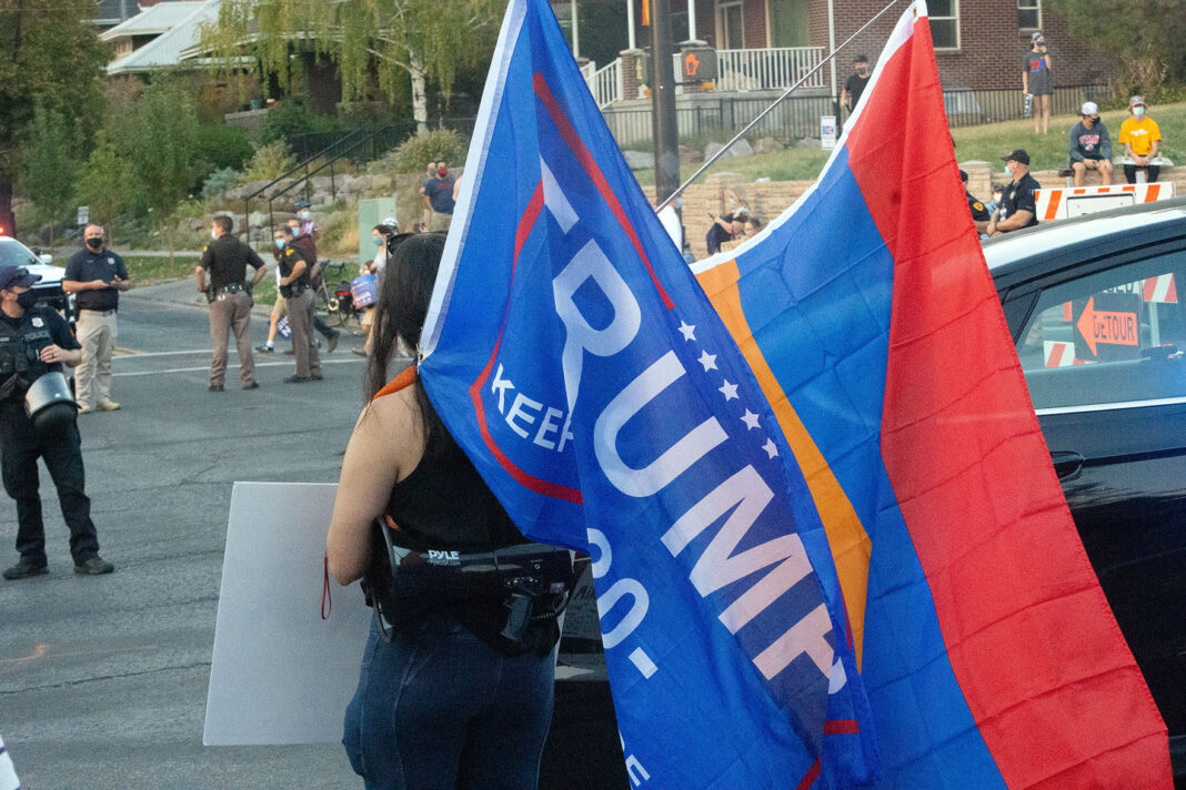 Protester carries flags on her shoulders