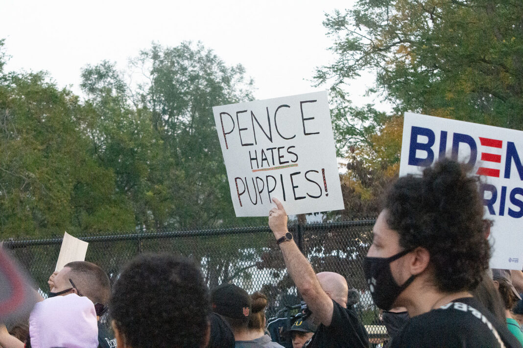 """Sign reads """"Pence hates puppies!"""""""