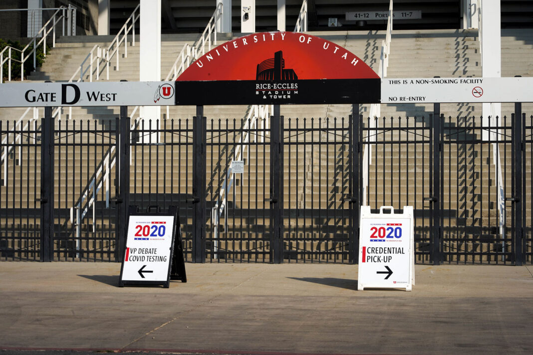 Two signs in front of Rice-Eccles Stadium