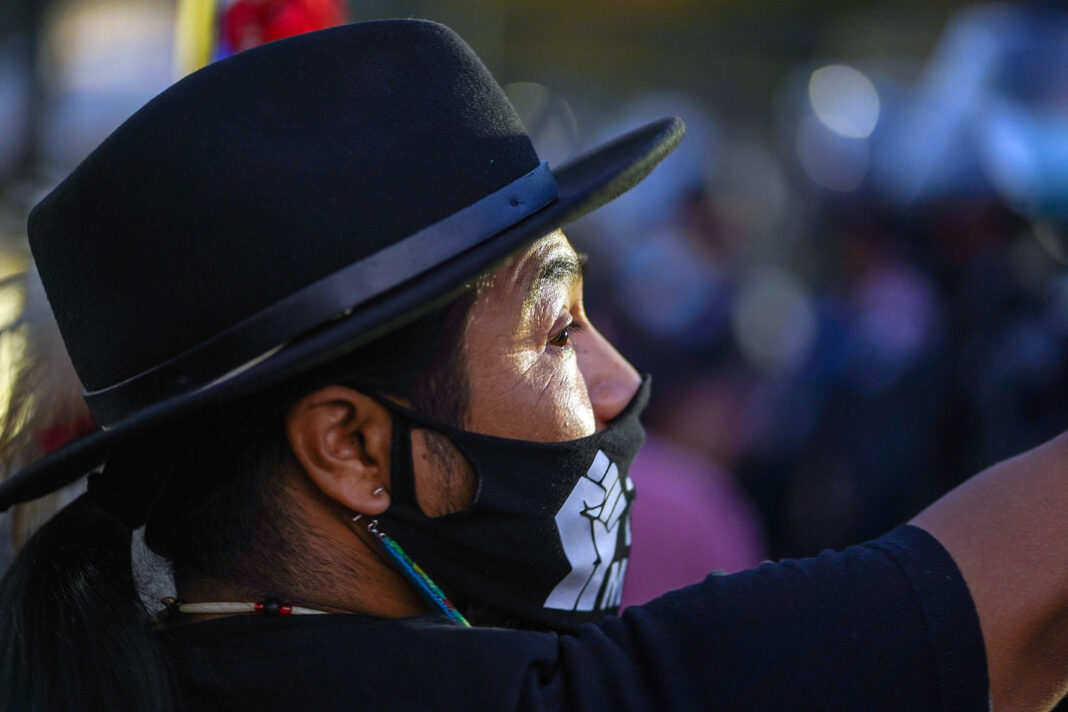 Carl Moore wears Black Lives Matter mask