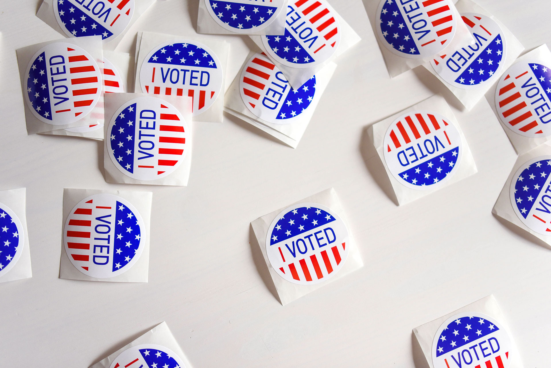 "Stickers with ""I voted"" inscription and flag of USA"