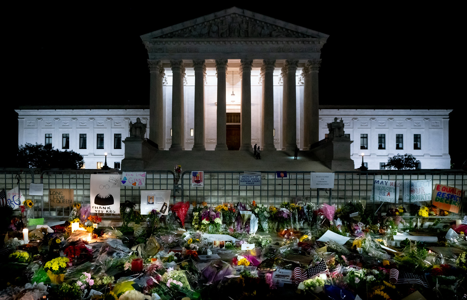 Tributes lay outside U.S. Supreme Court at night