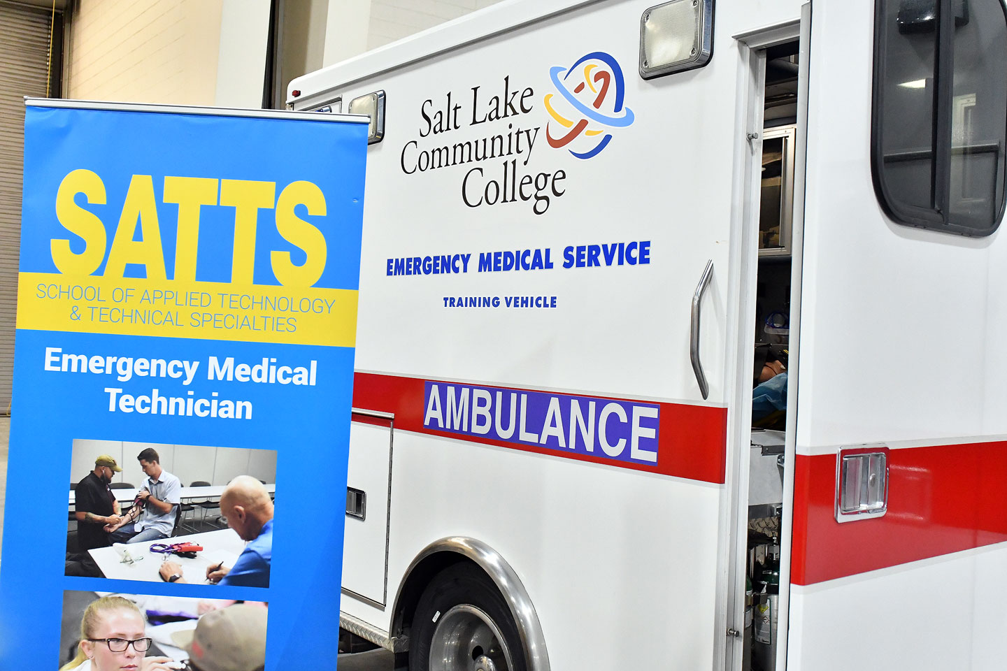 SATTS banner next to SLCC training ambulance