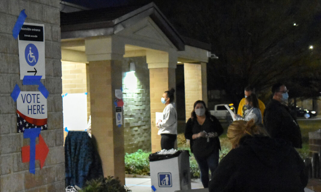 Voters wait outside library