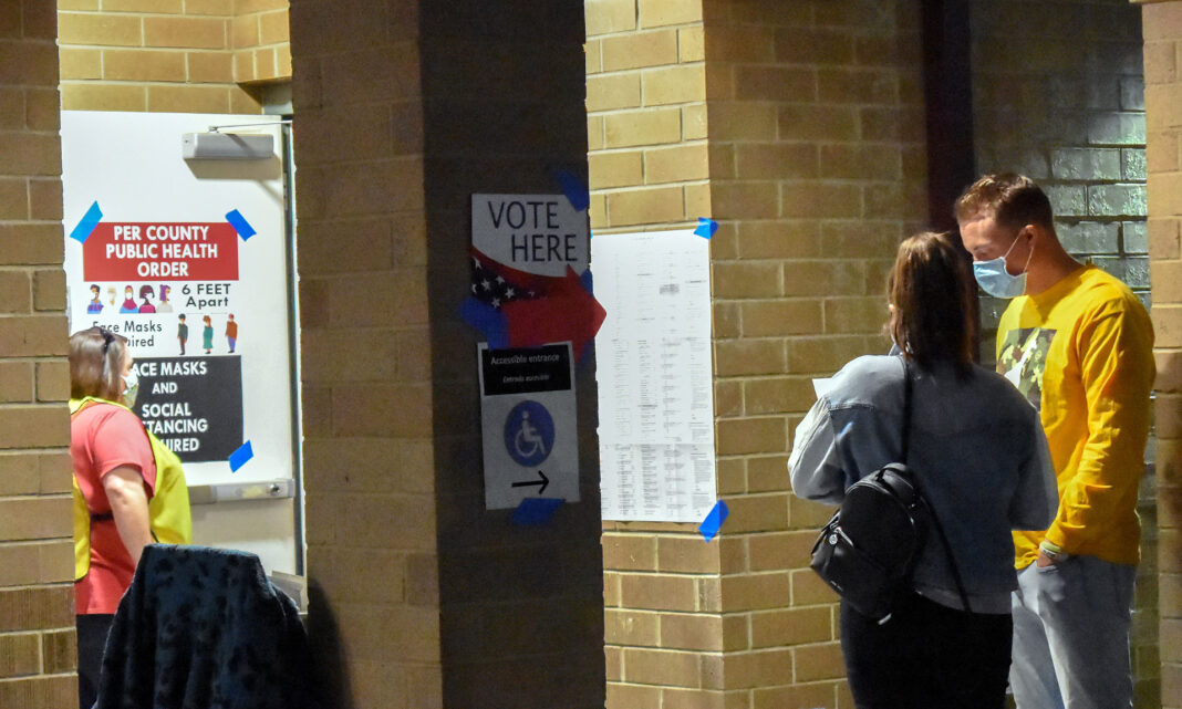 Voters put on masks