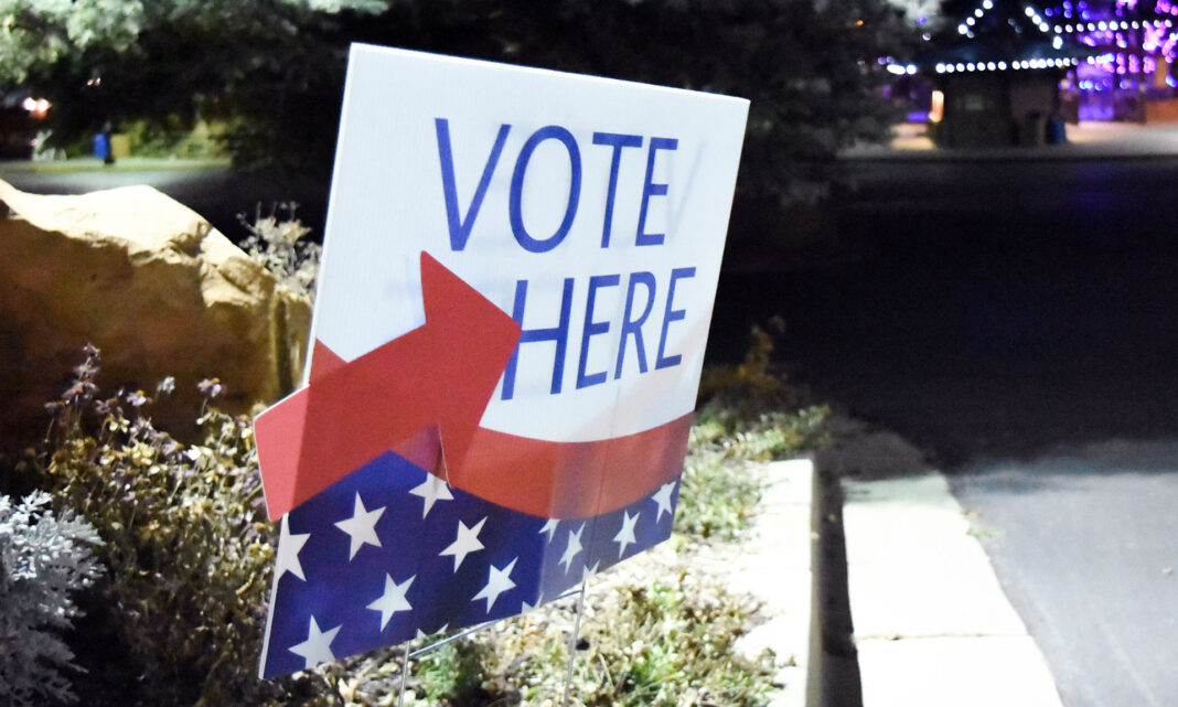 Vote Here sign by Hogle Zoo
