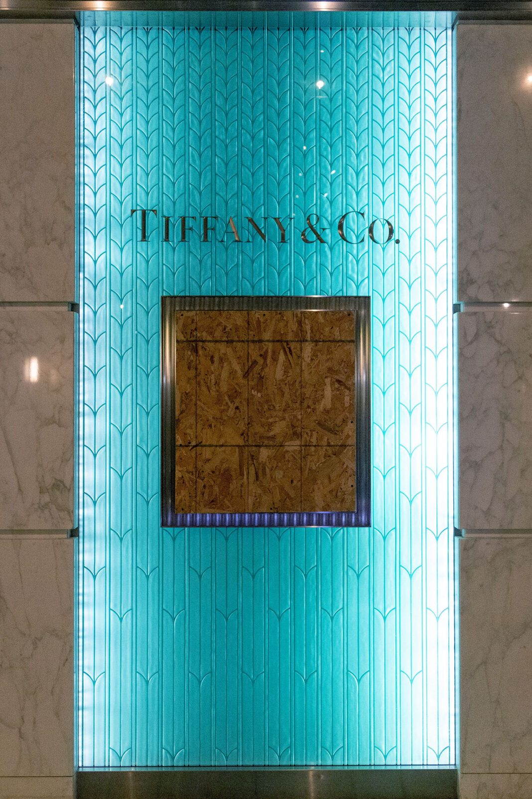 Plywood covers Tiffany and Co. window
