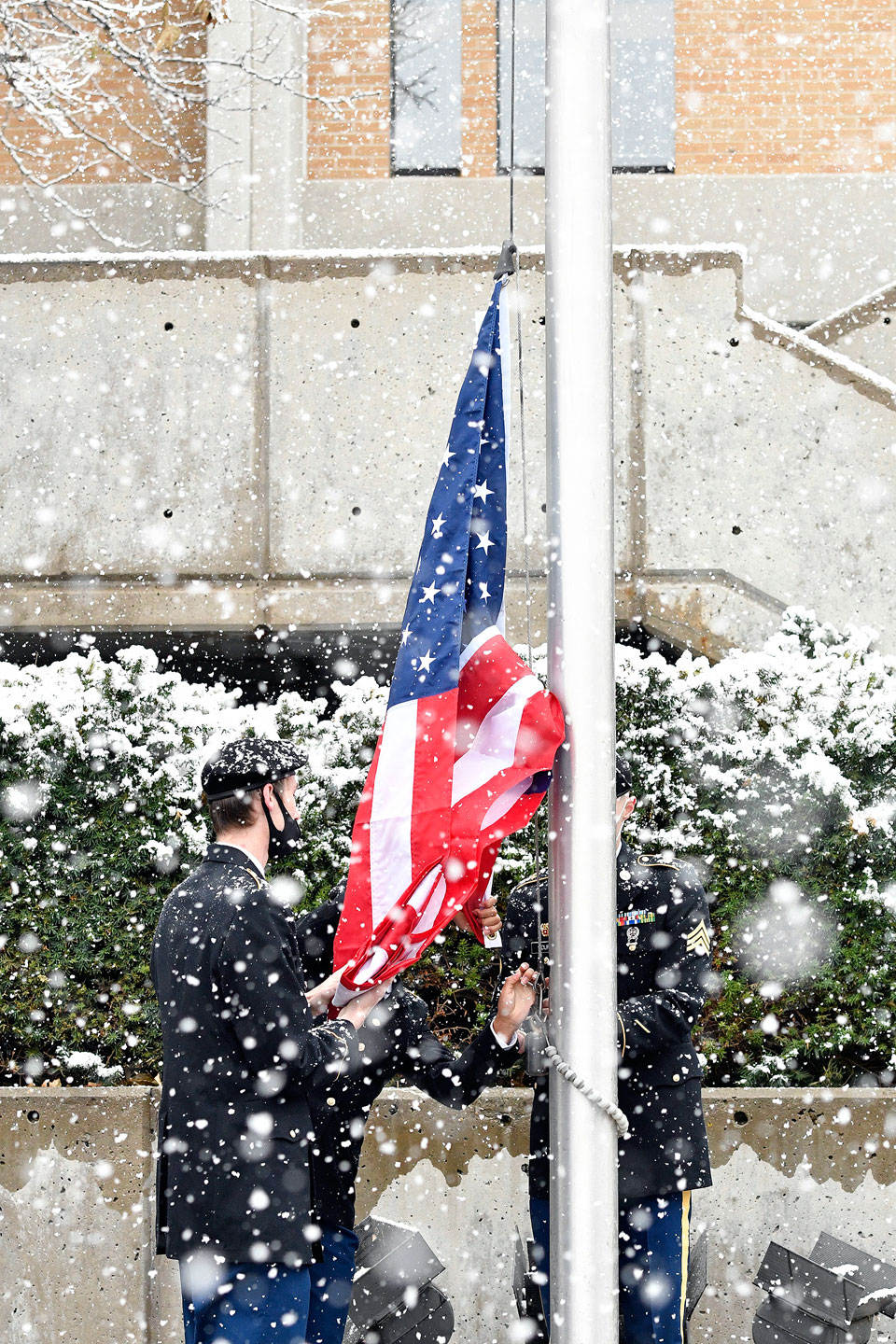 Raising a new American flag in the snow
