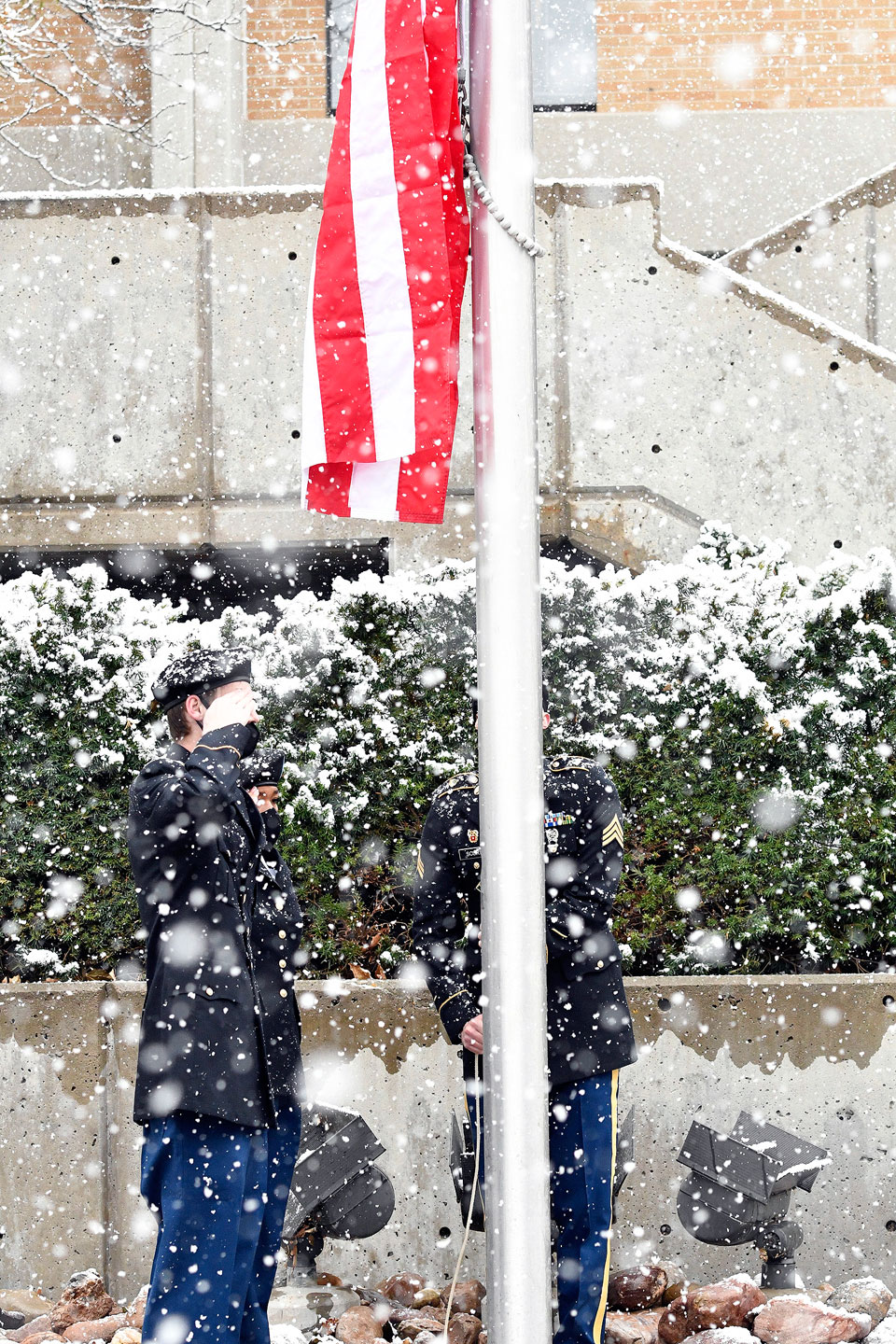 Raising a new American flag in snowy weather