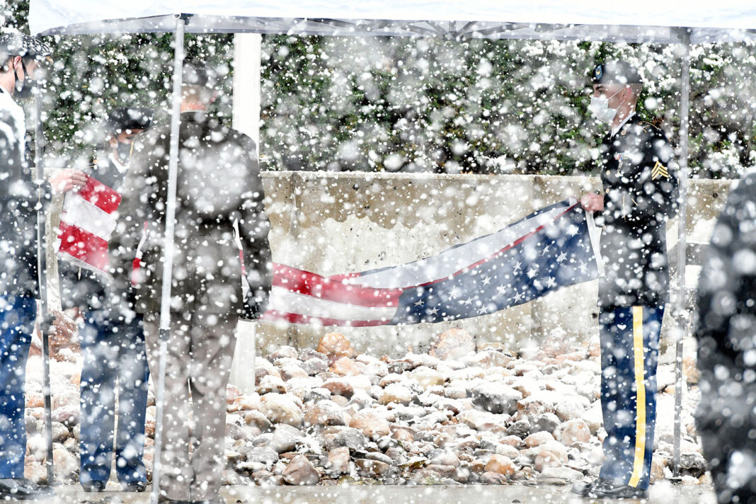 Folding the American flag in snowy weather