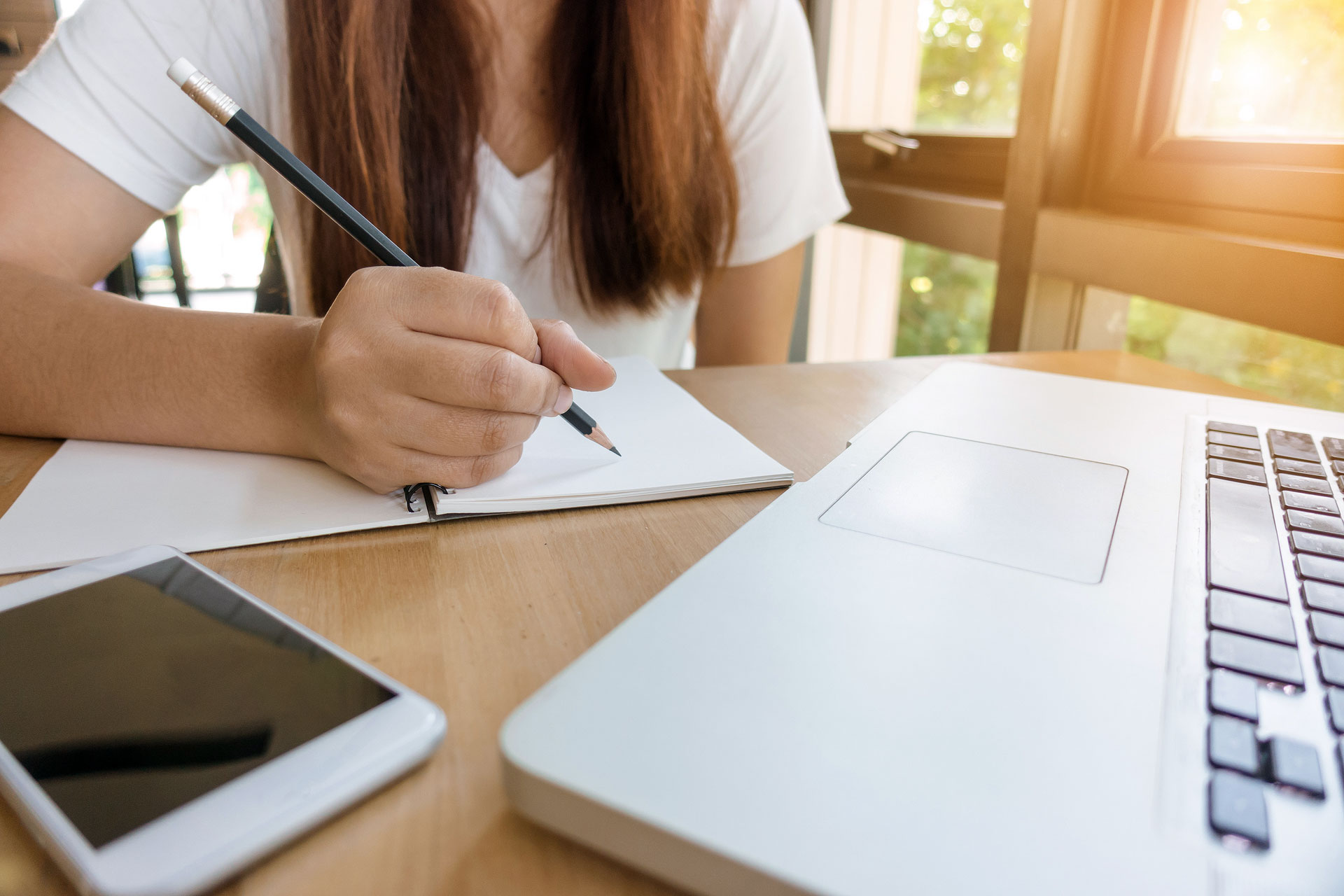 Female student taking notes