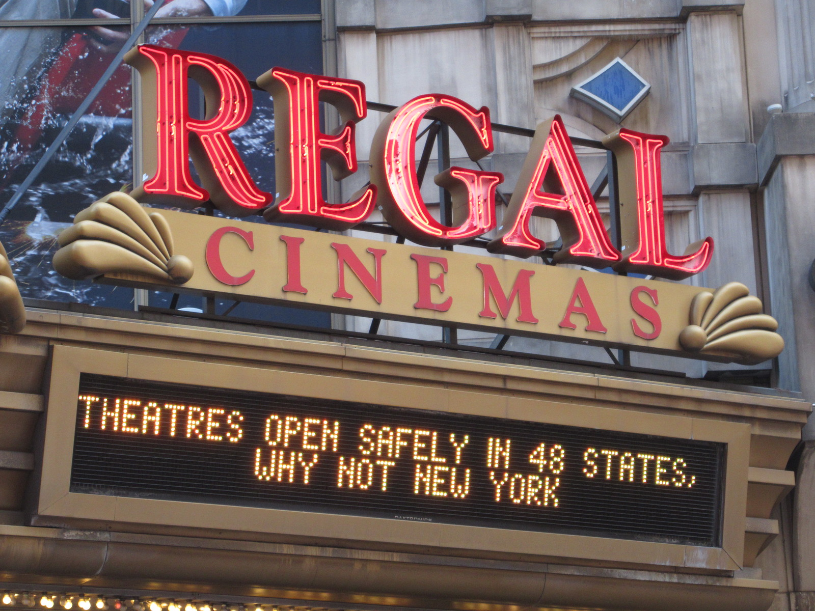 "Regal Cinemas sign says ""Theatres open safely in 48 states, why not New York"""