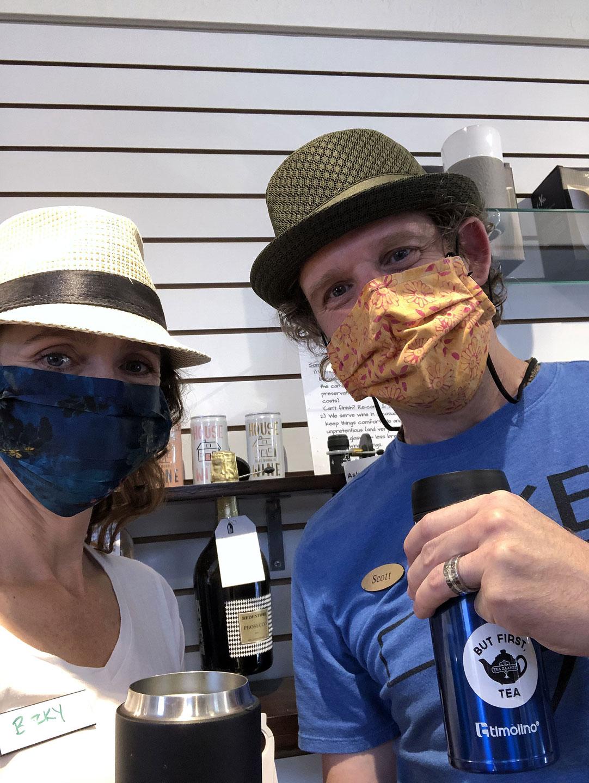 Becky Lyttle, left, and Scott Lyttle wear masks