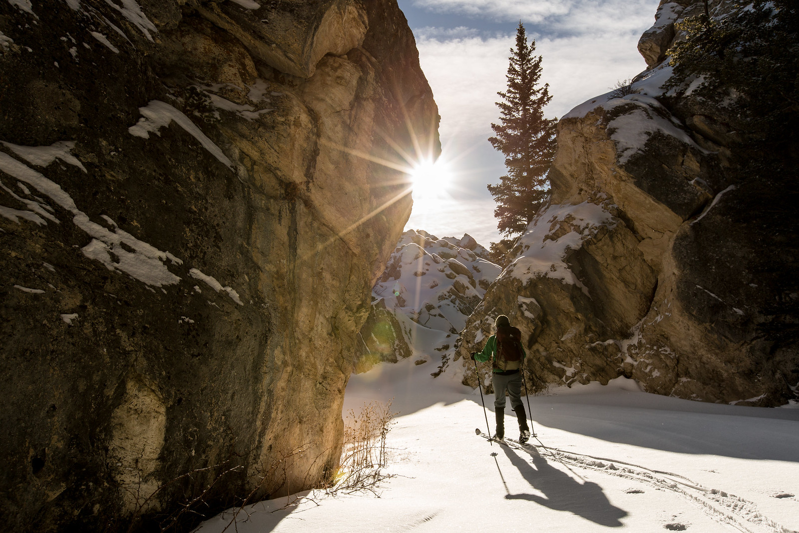 Man cross country skiing in snowy mountain