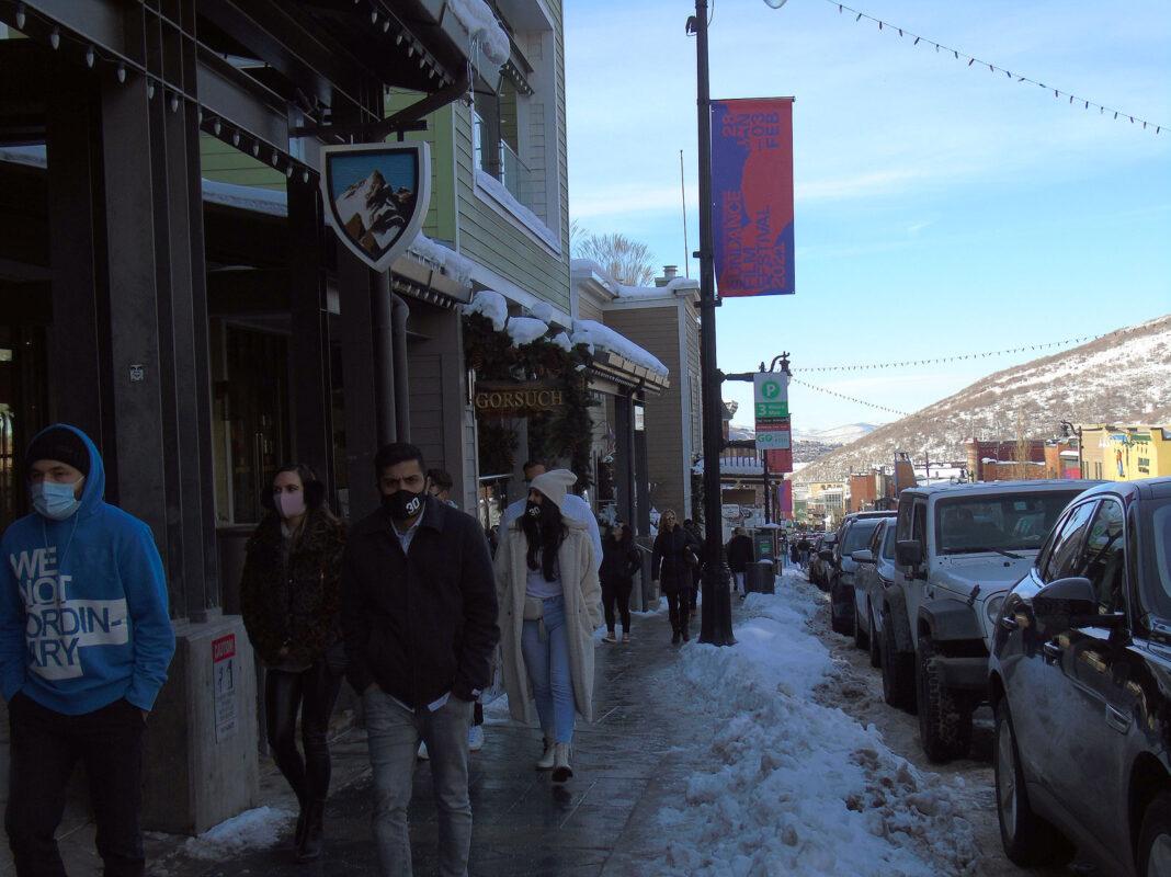 People walking down Park City Main Street