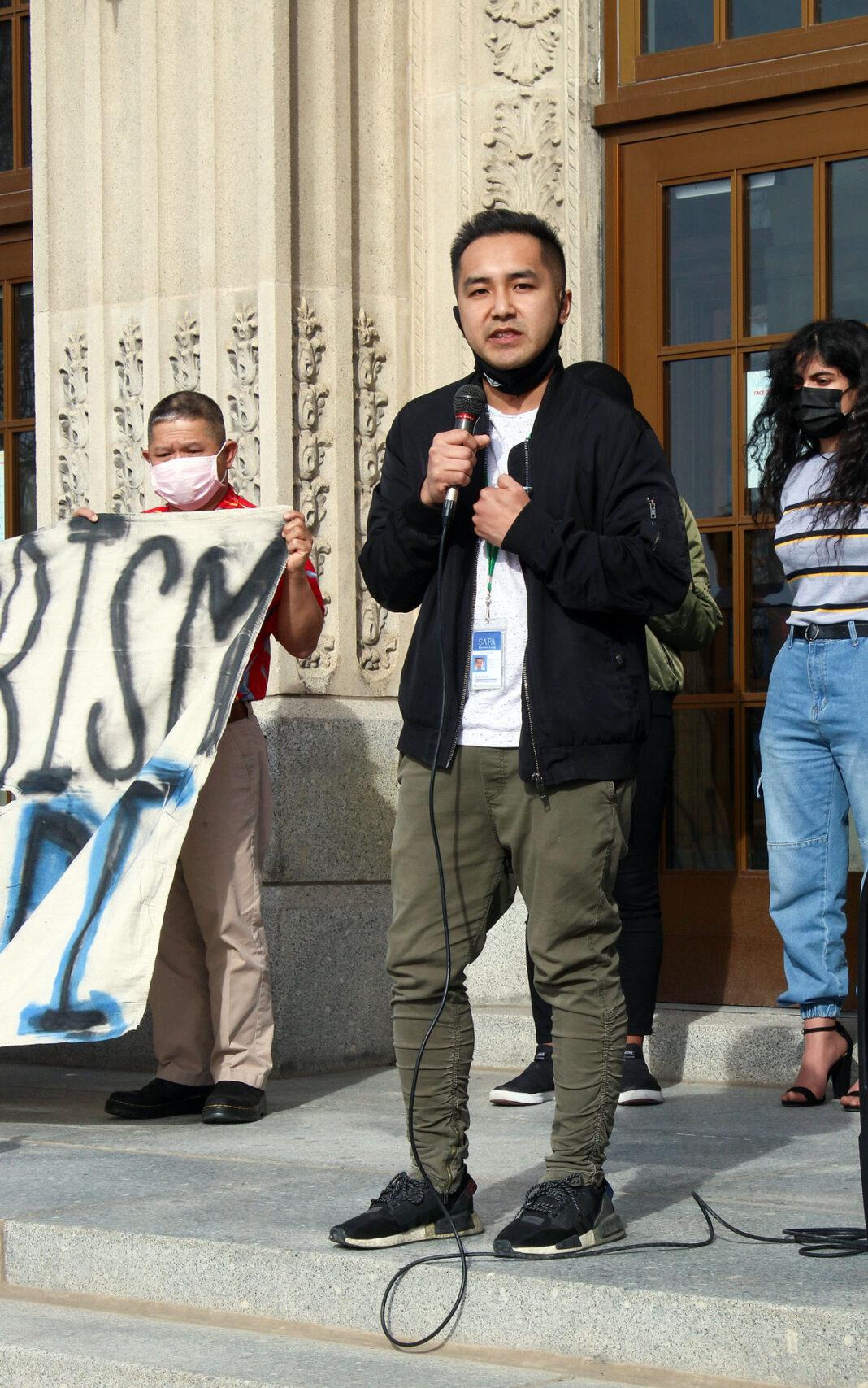Ricky Panh speaking at vigil