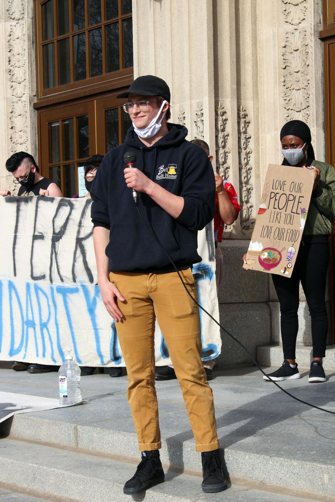 Young man speaking at vigil