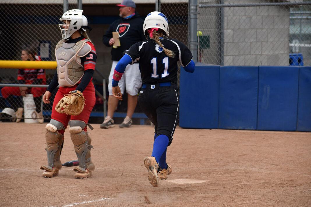 Allie Laub runs home