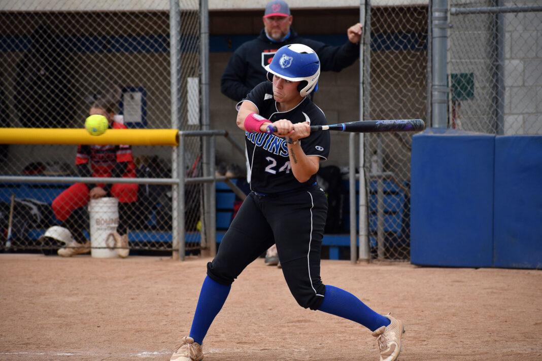 Mackenzy Richins swings at approaching ball