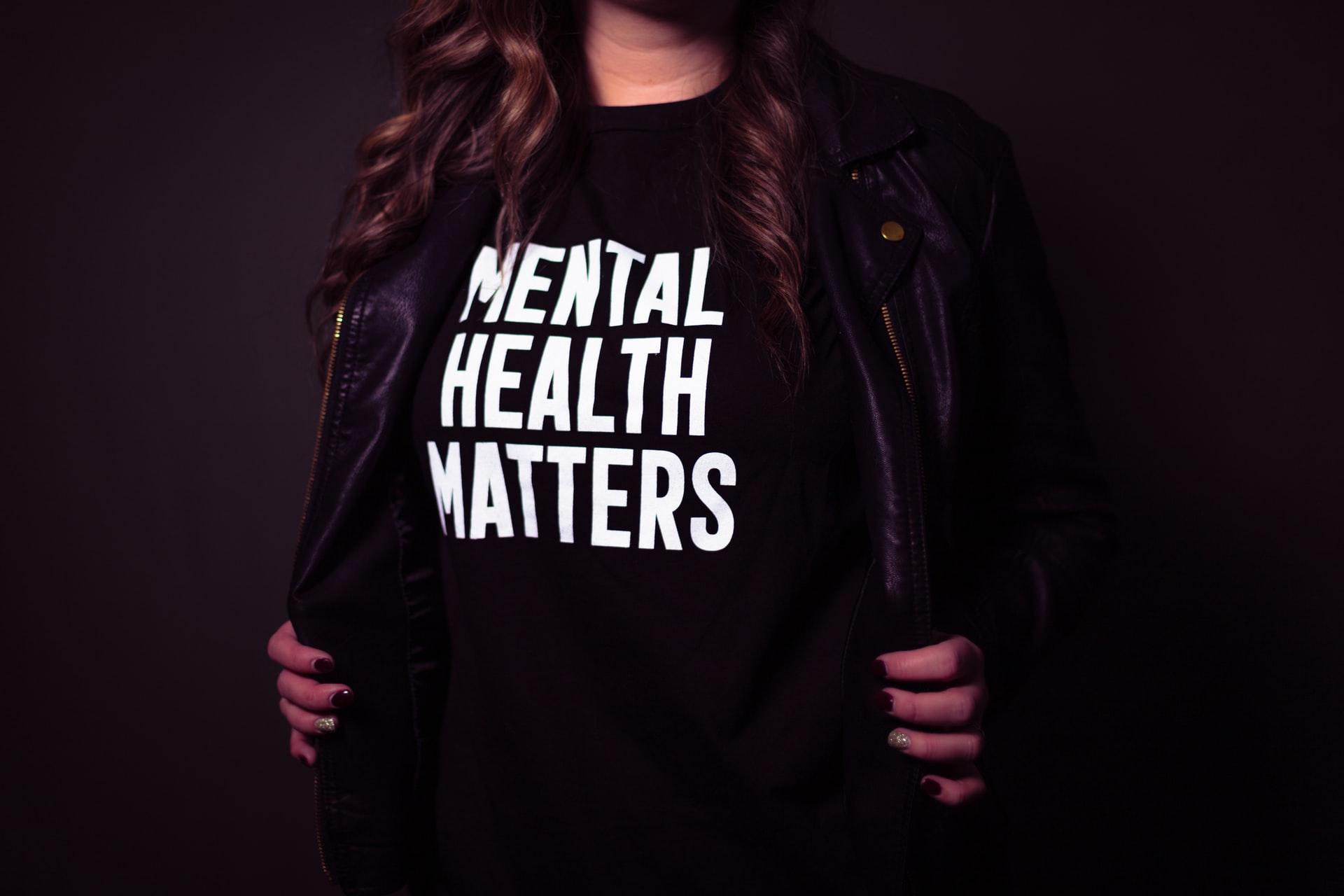 "Woman wears t-shirt that reads ""mental health matters"""