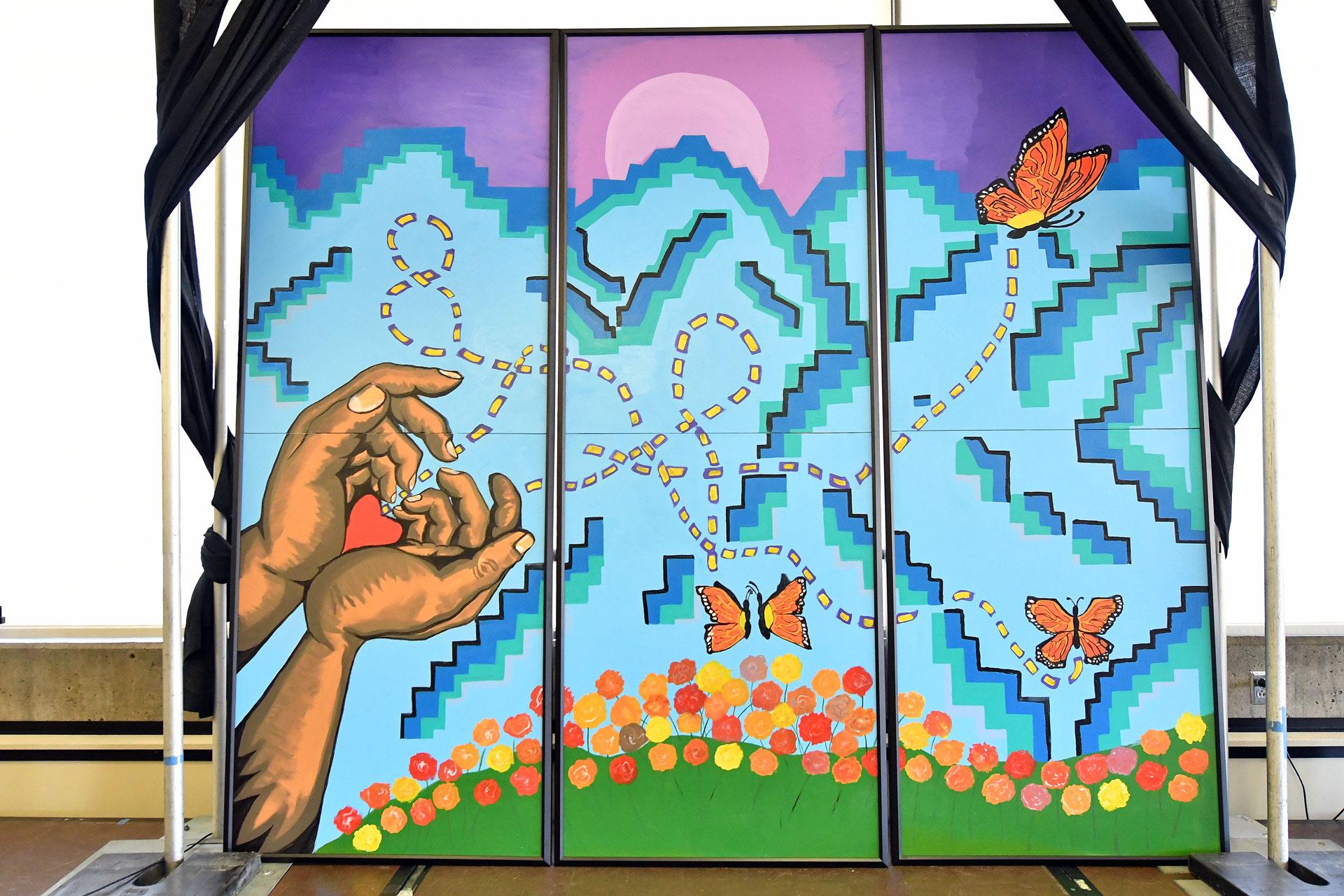 Mural of hands releasing butterflies