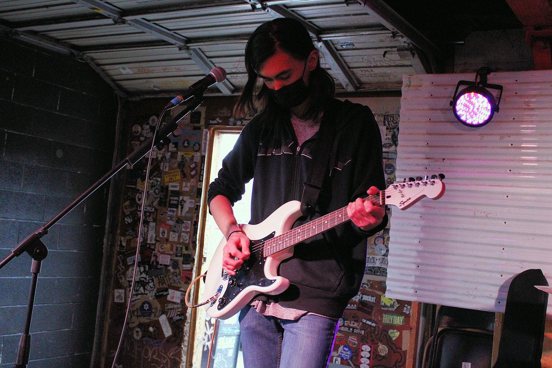 Alex Nuntapreda playing guitar
