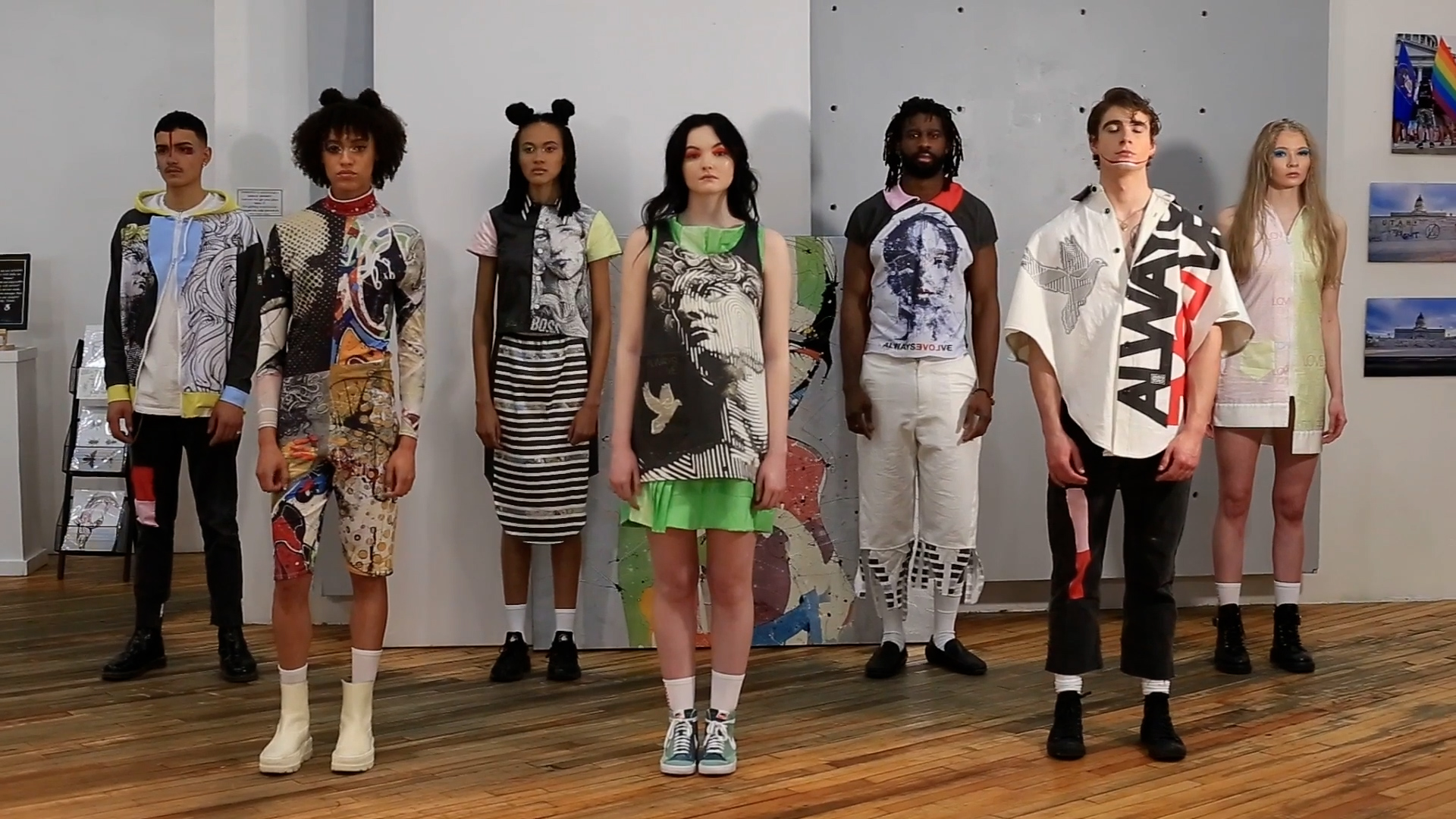 Several models wearing different clothing designs