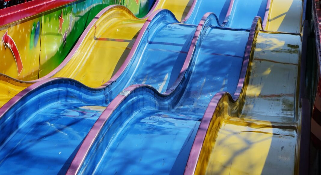 Row of yellow and blue water slides