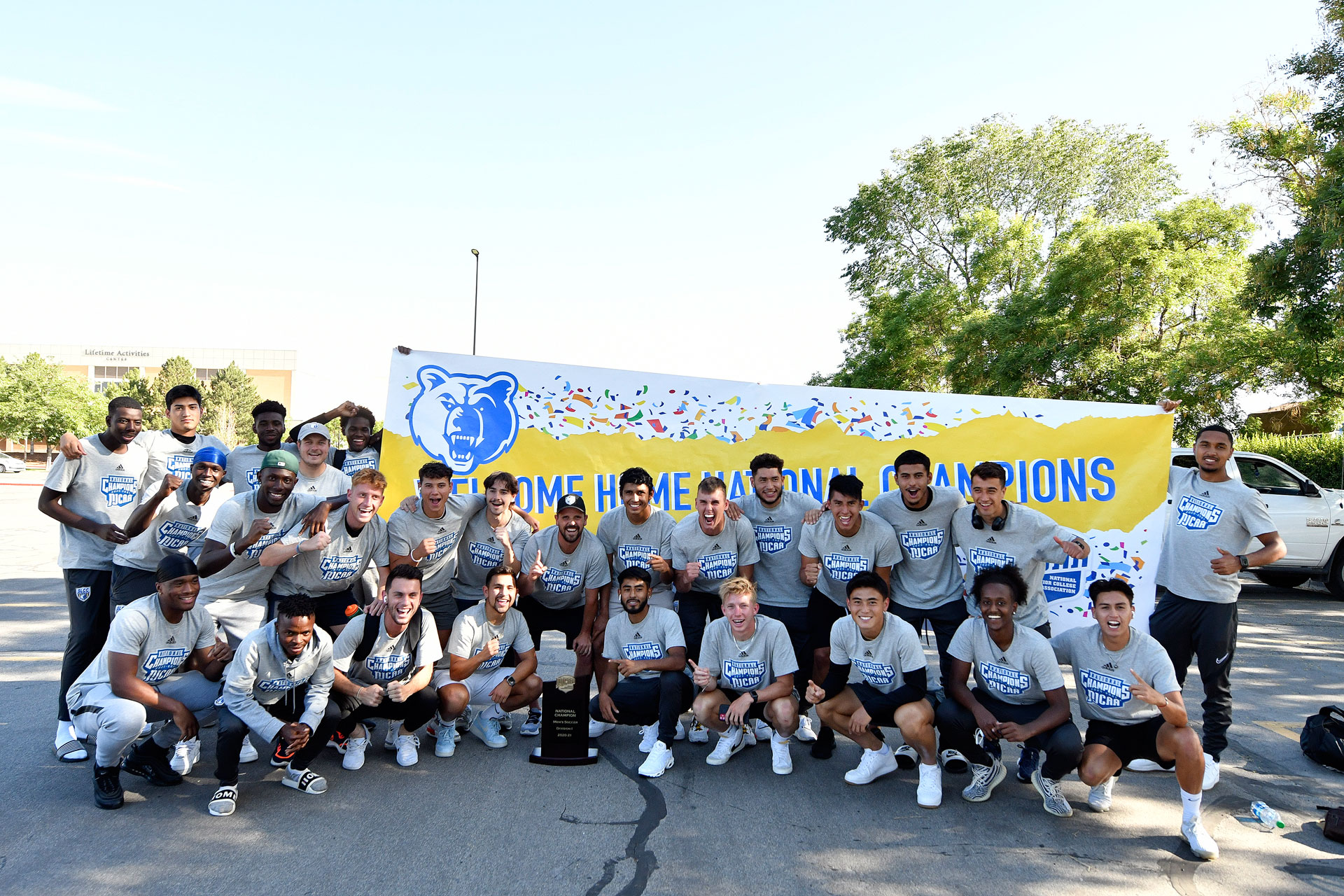 Men's soccer team at the championship welcome party