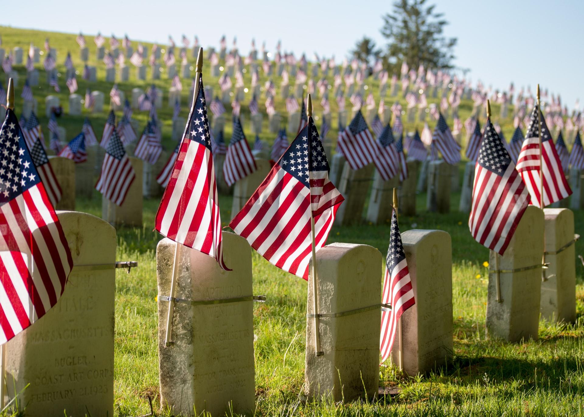 American flags on cemetery headstones