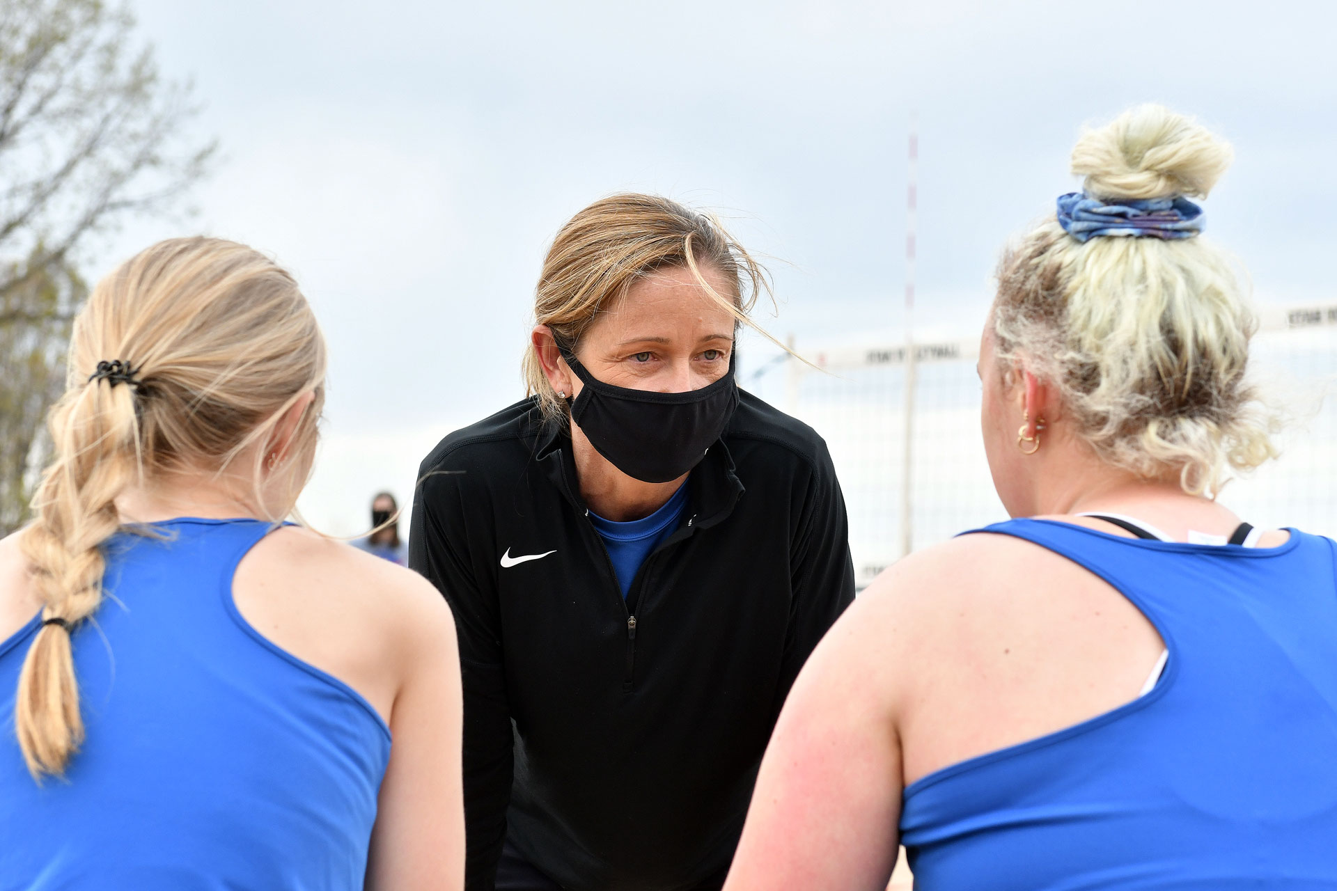 Shay Goulding-Meurer coaches two beach volleyball players