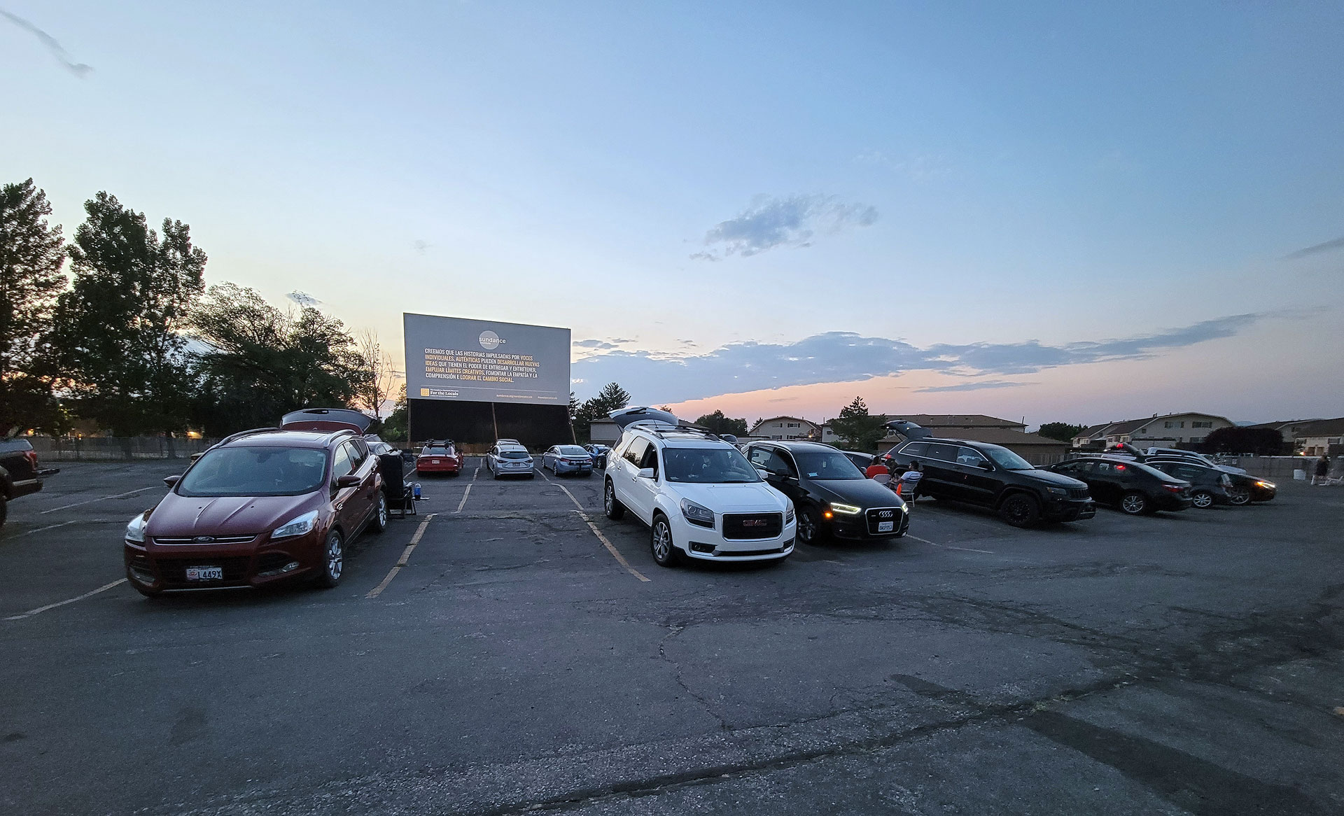 Cars backed up to giant film projection screen