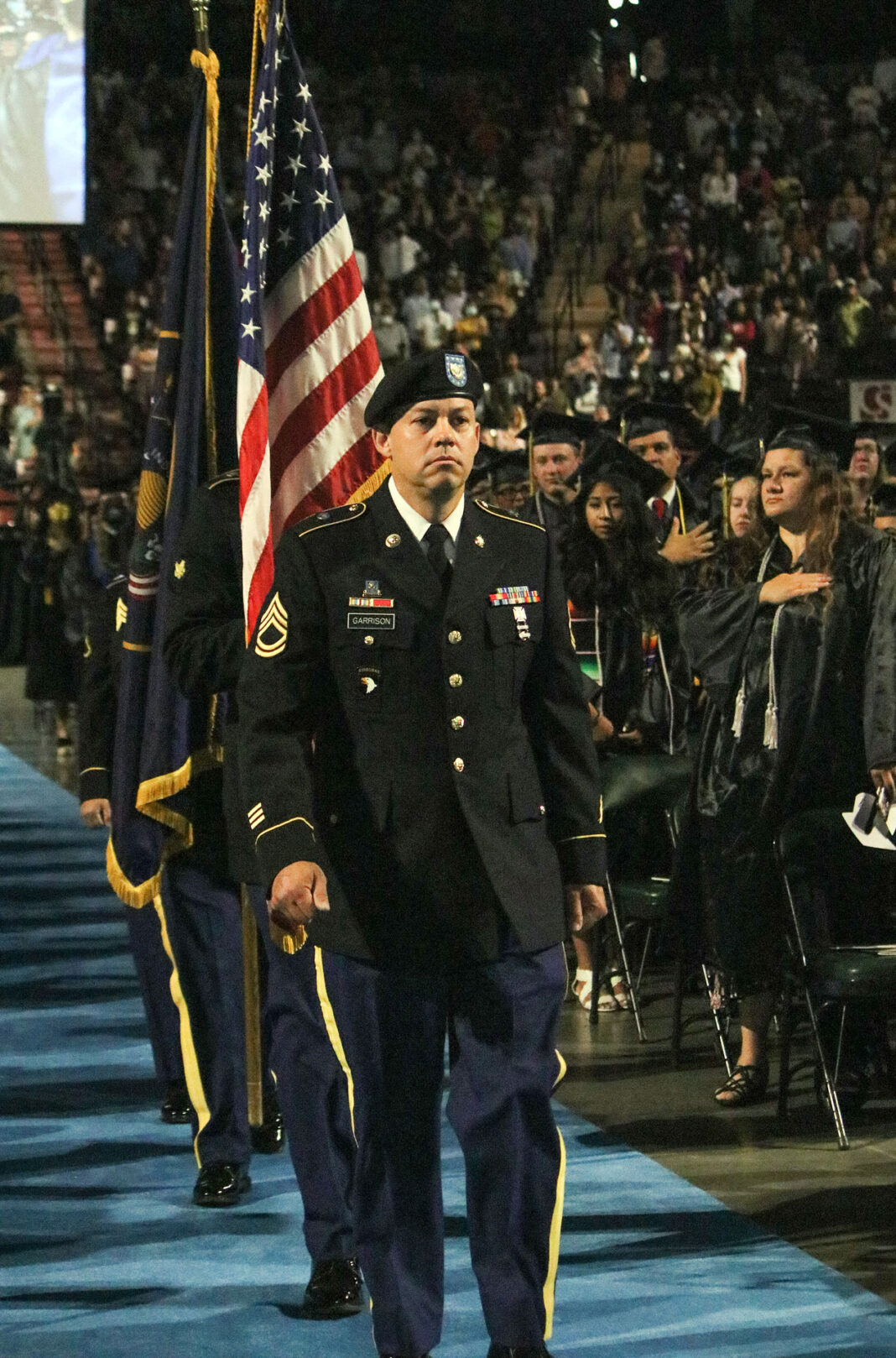 National Guard walks past SLCC graduates