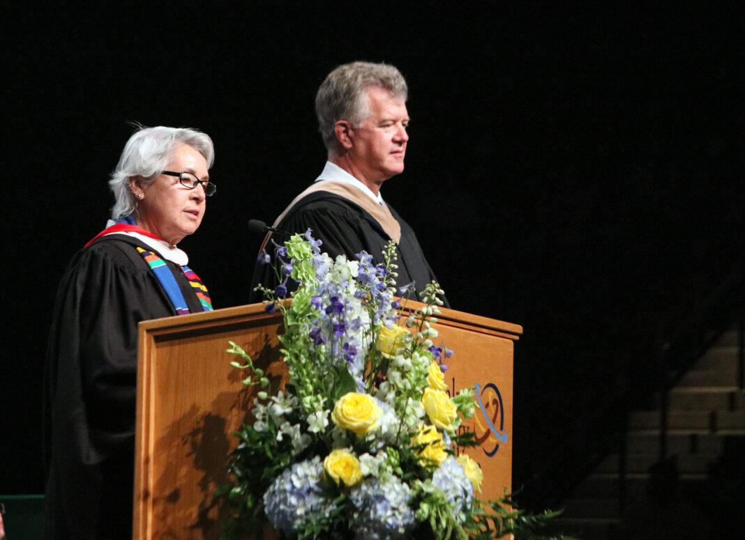 Maria Farrington, left, honors Terry L. Grant