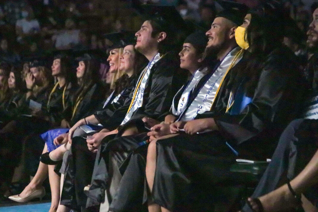 Row of graduating students smiling