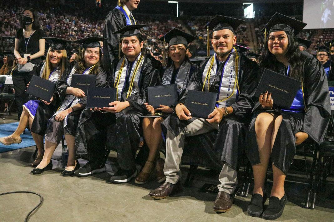 SLCC graduates smile for a picture