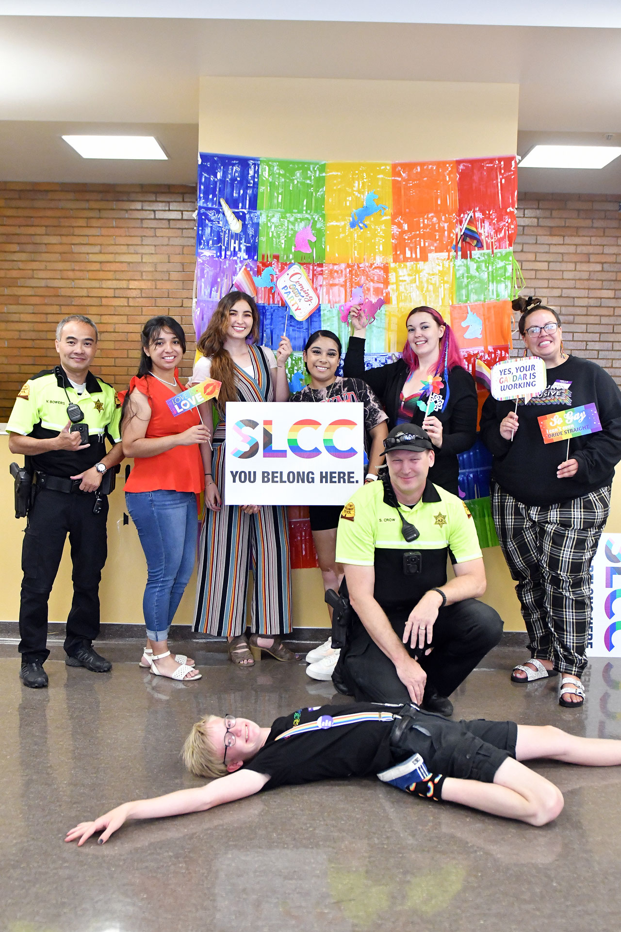 Students and officers pose for a photo