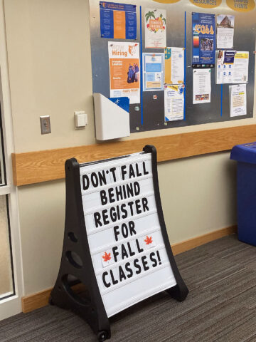 """Sign reads """"Don't fall behind register for fall classes!"""""""
