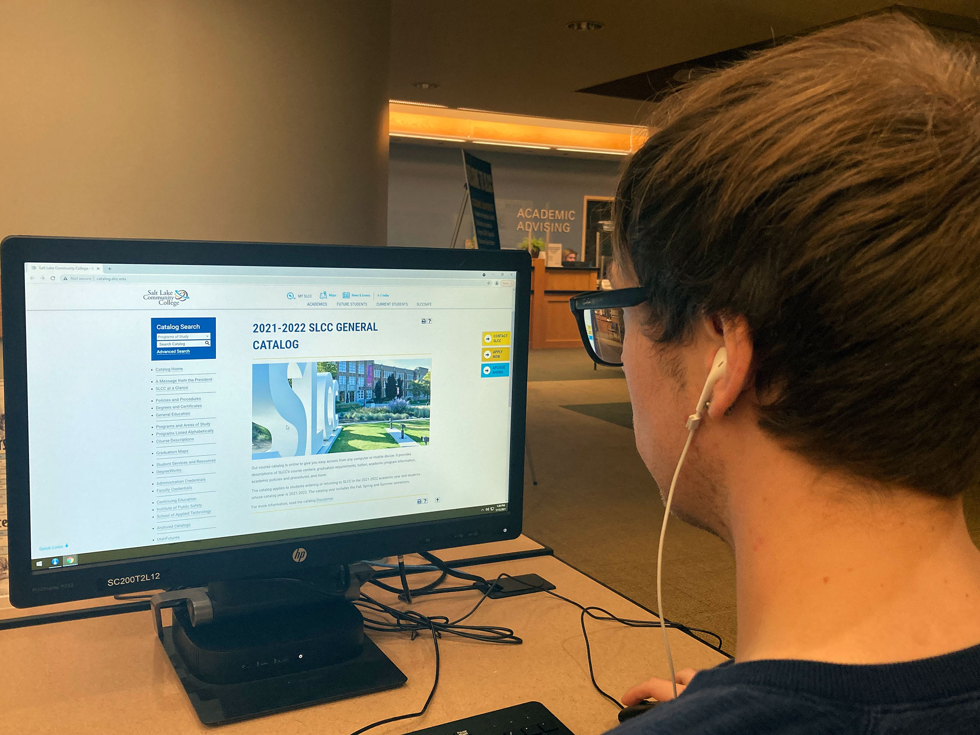 Student browsing the SLCC catalog web page