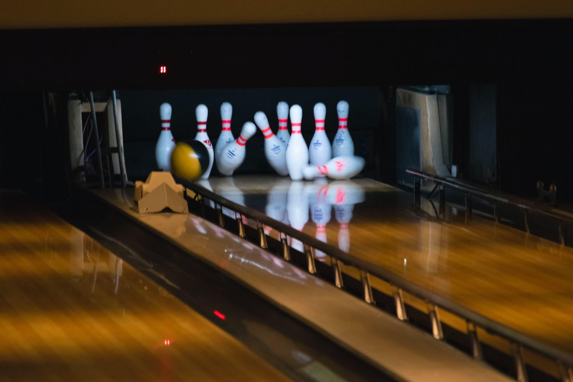 Bowling ball strikes bowling pins