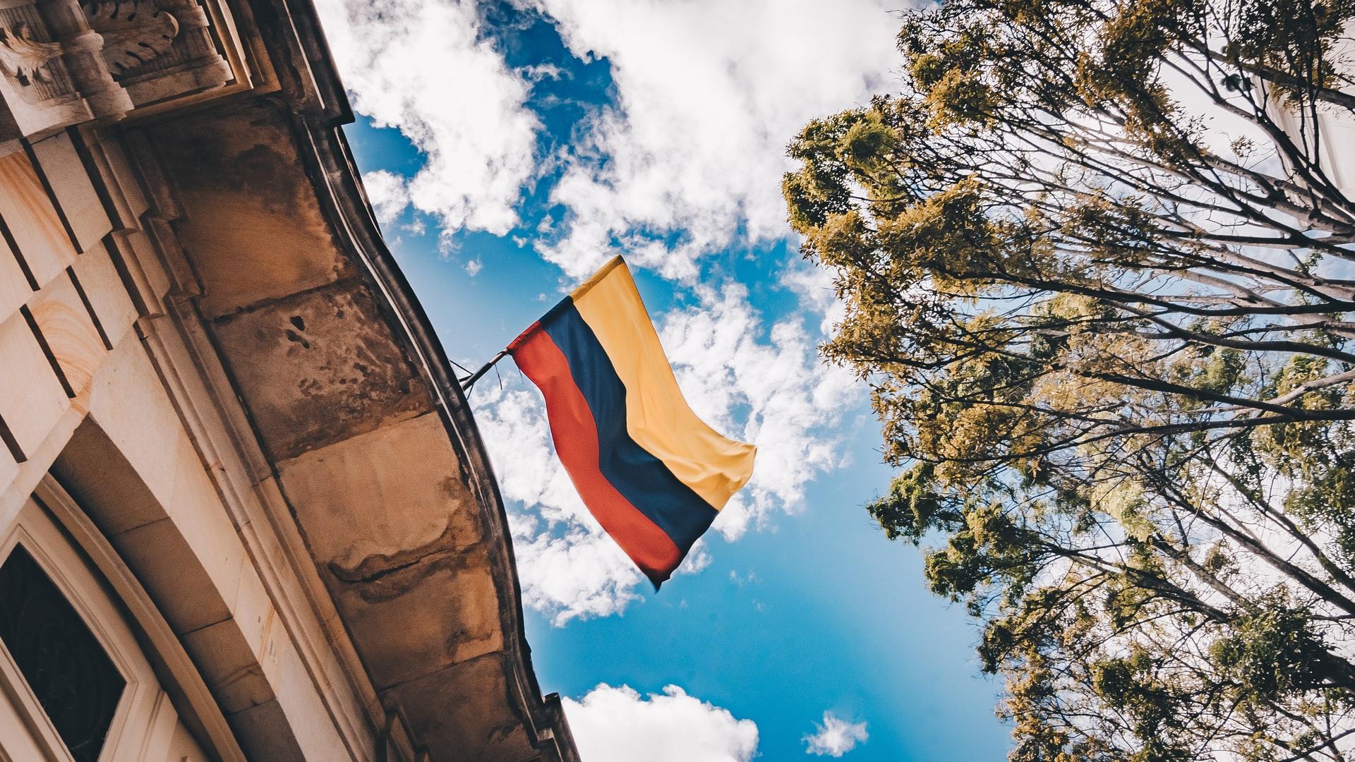Colombian flag waving overhead