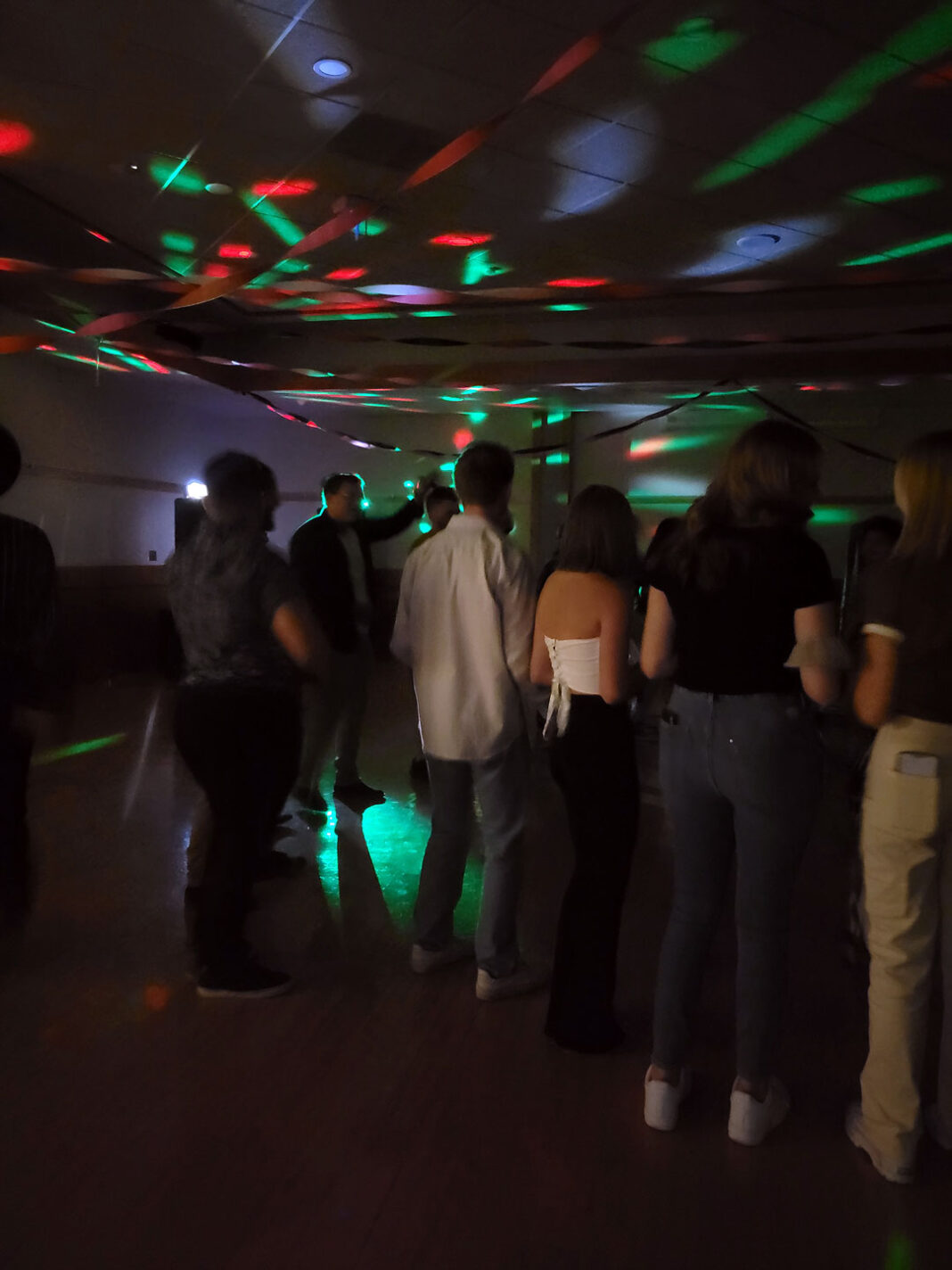 People dancing under flashing lights