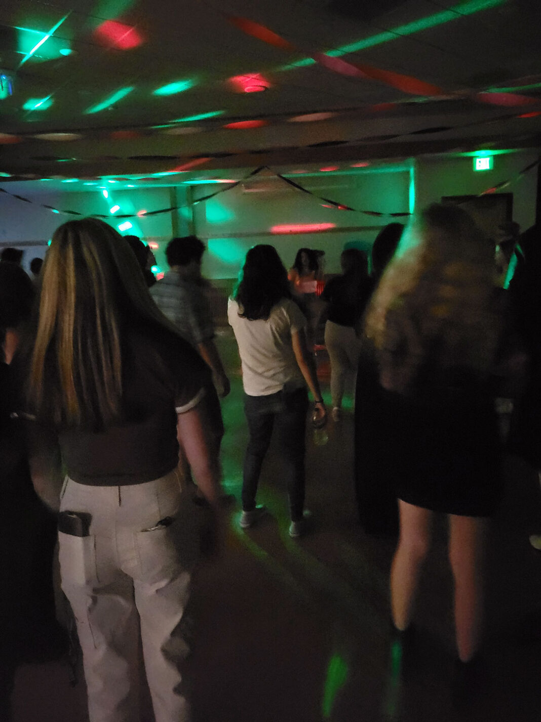 People lined up to dance under strobe lights
