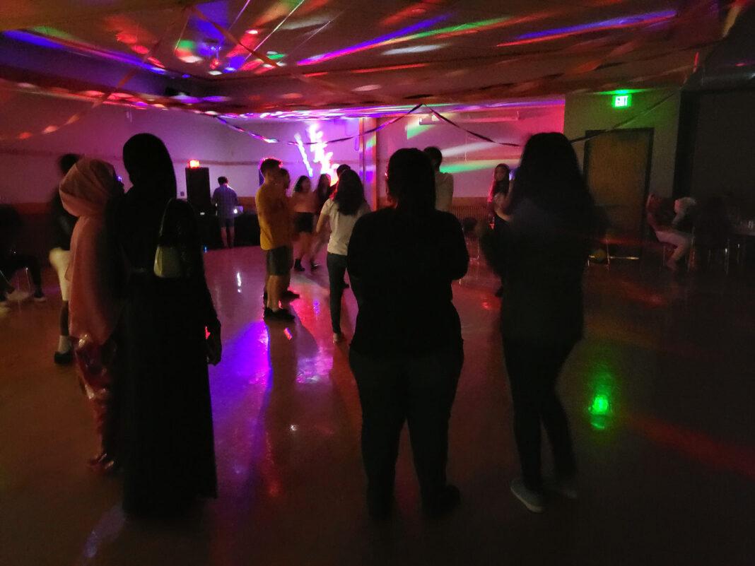 Students dancing inside